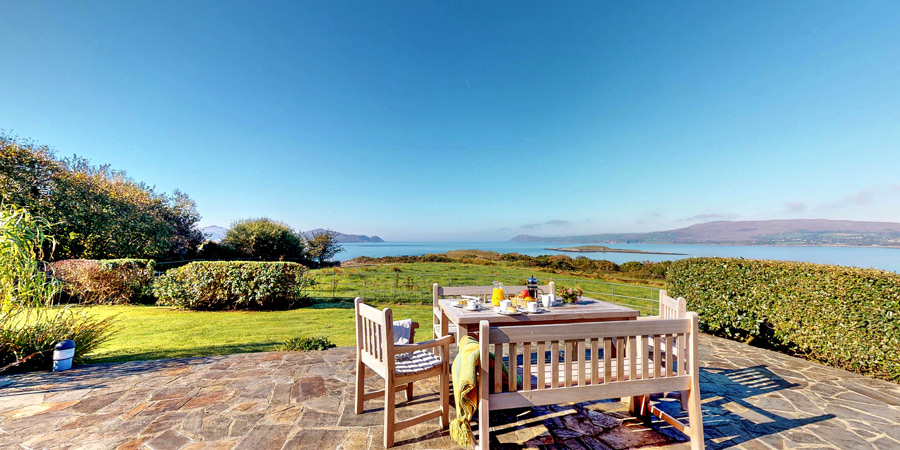 ballyvonane-house-terrace-sea-view-900x450